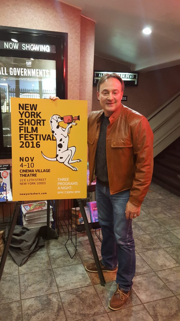 Alan Fine with New York Short Film Festival 2016 poster