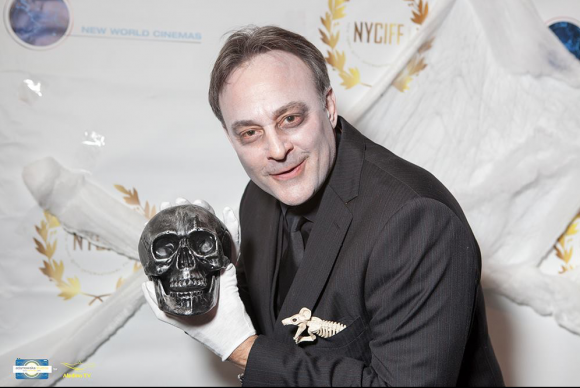 Alan Fine, in costume as a ghoulish writer/director, receives the Best Short Screenplay award